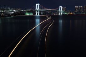 Yasushi Okumura - Light trails of houseboats and Rainbow Bridge at Tokyo, Japan