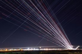 Yasushi Okumura - Startrails and Airplanetrails over the Narita International Airport at SakuranoYama park, Japan